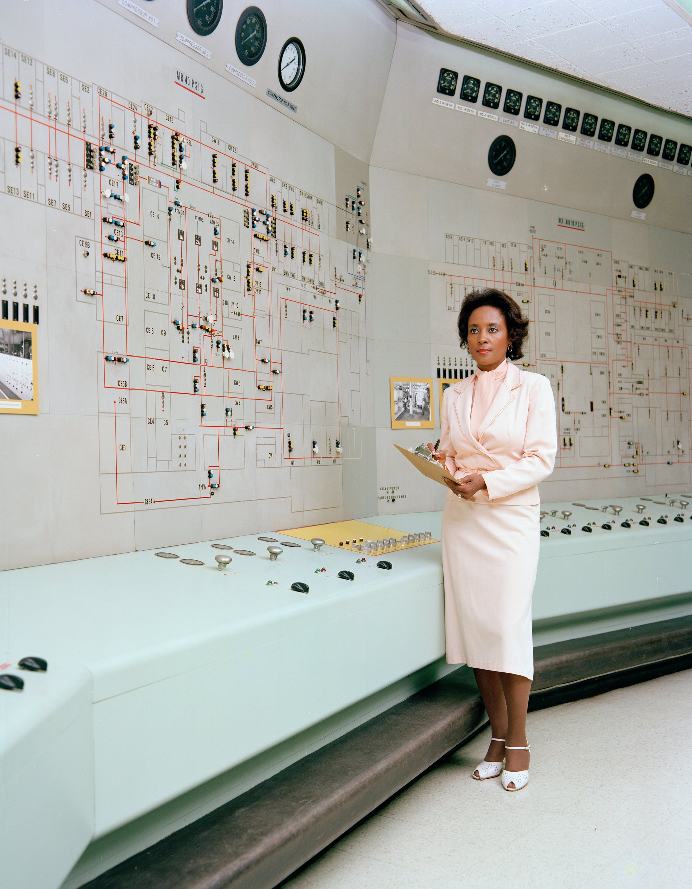 Annie Easley standing in a computer room