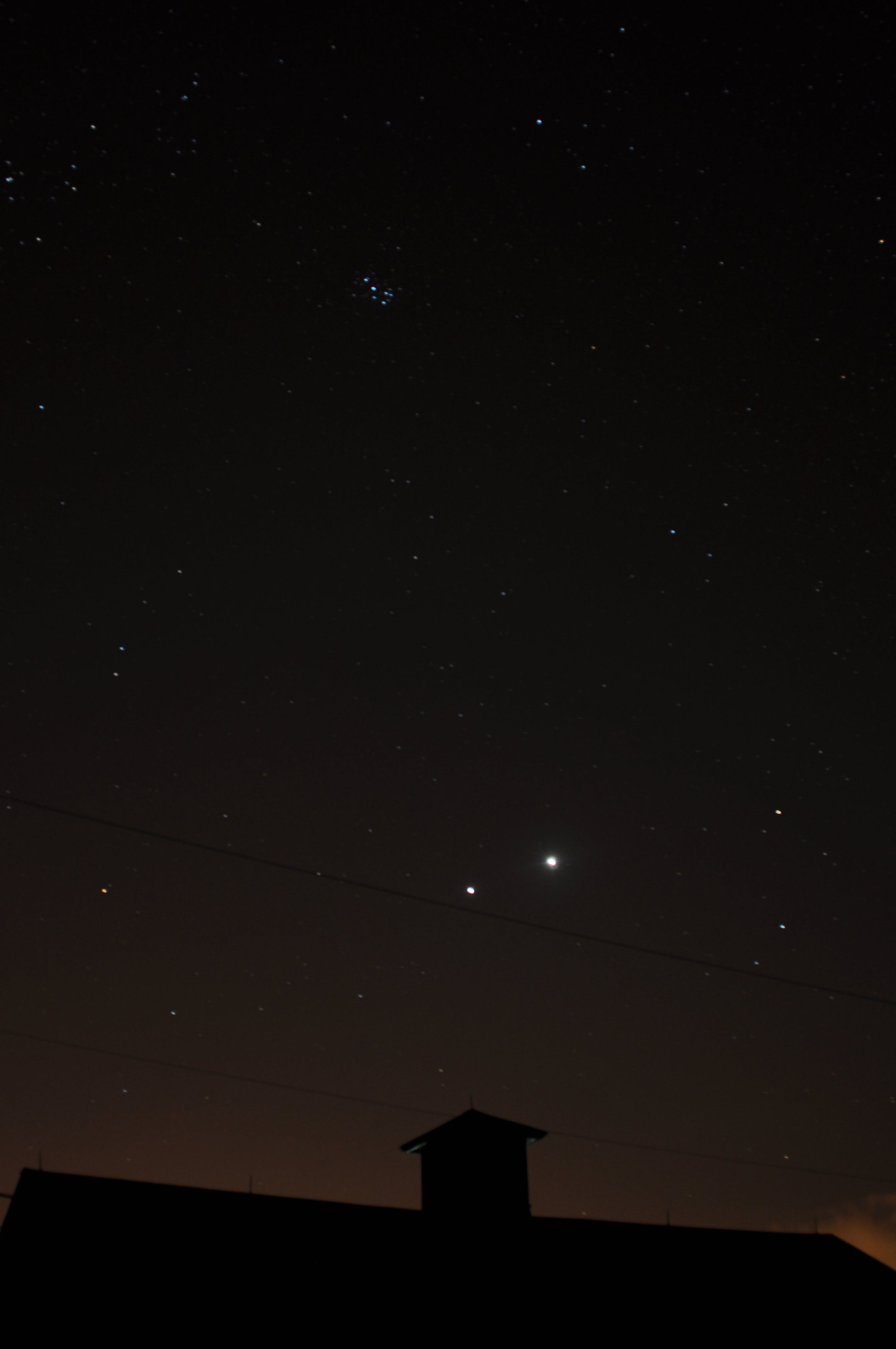 A picture of the night sky, showing Venus and Jupiter in conjunction, and the Little Dipper at the top.