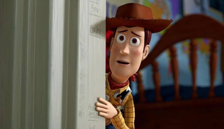 Woody wearing around a door frame