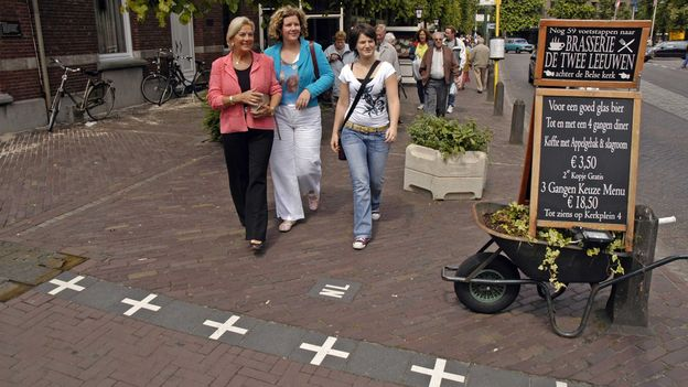 The borders are marked by white crosses with 'NL' on one side and 'B' on the other (Credit: Credit: Toerisme Baarle)