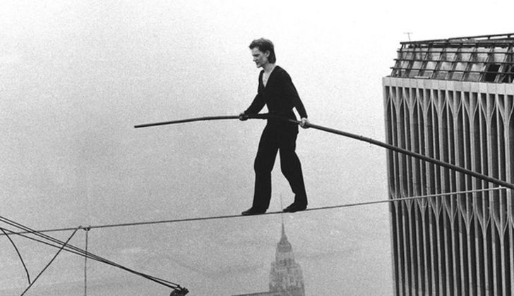 Philippe Petit walking wire between the Twin Towers
